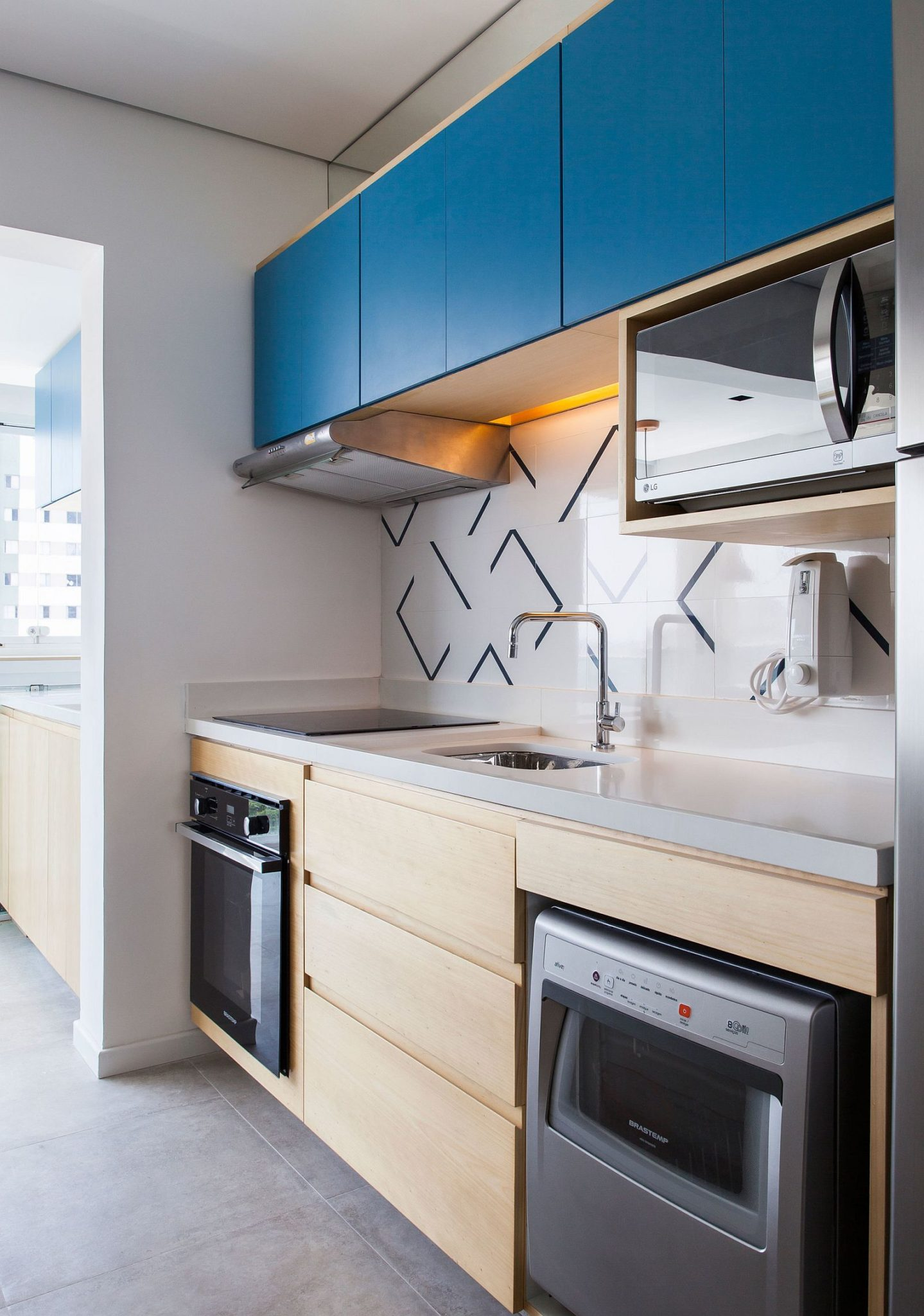 Tiny kitchen with bright blue top cabinets