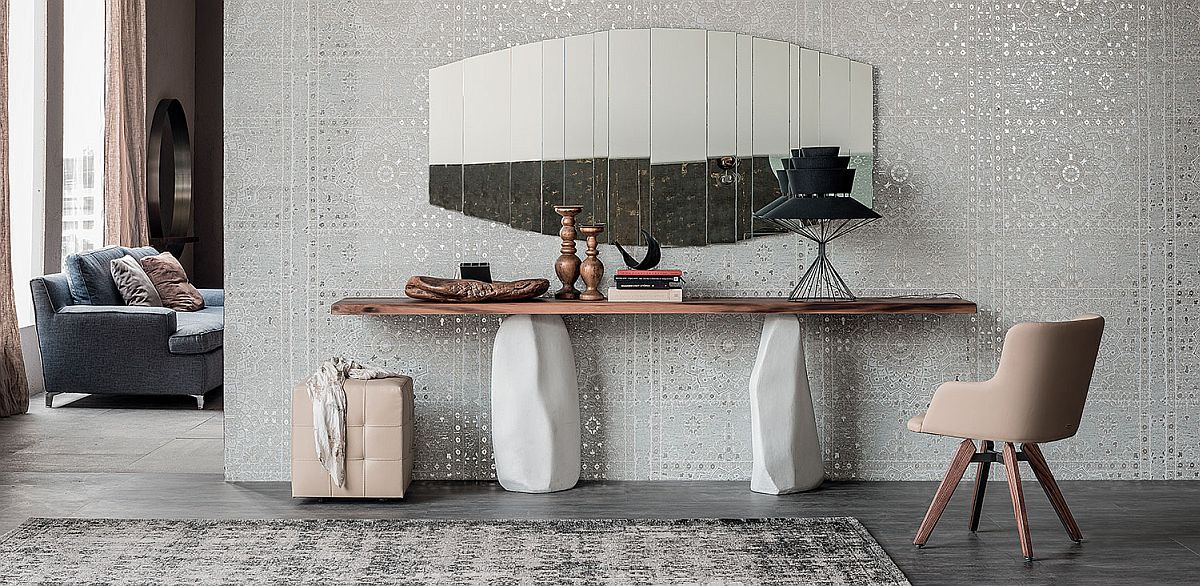 Unique cement legs of the console table make it an outstanding living room addition