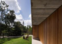 Wall-with-wooden-slats-and-doors-lets-filtered-light-to-come-through-217x155