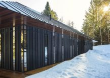 Wooden-siding-polished-steel-and-glass-panels-along-with-the-metallic-roof-make-a-big-impression-217x155