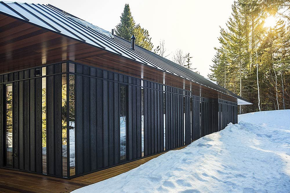 Wooden siding polished steel and glass panels along with the metallic roof make a big impression