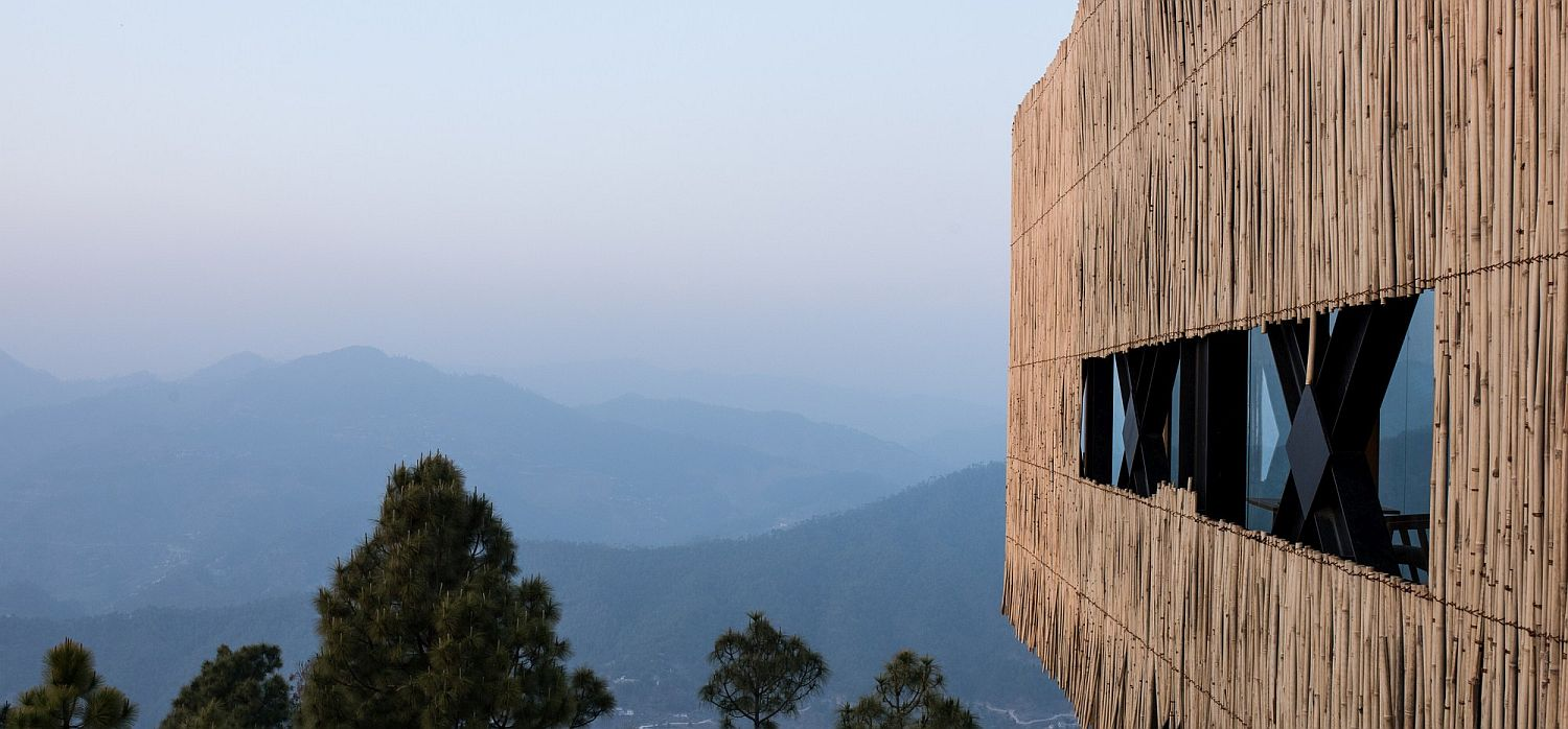 Bamboo cladding of the top level gives the hotel its rustic charm