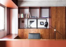 Bold-burgundy-metallic-sheet-becomes-the-work-desk-inside-the-home-office-217x155
