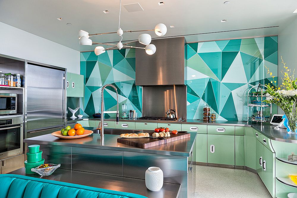 Brilliant backsplash in multiple shades of greenish-blue steals the show here