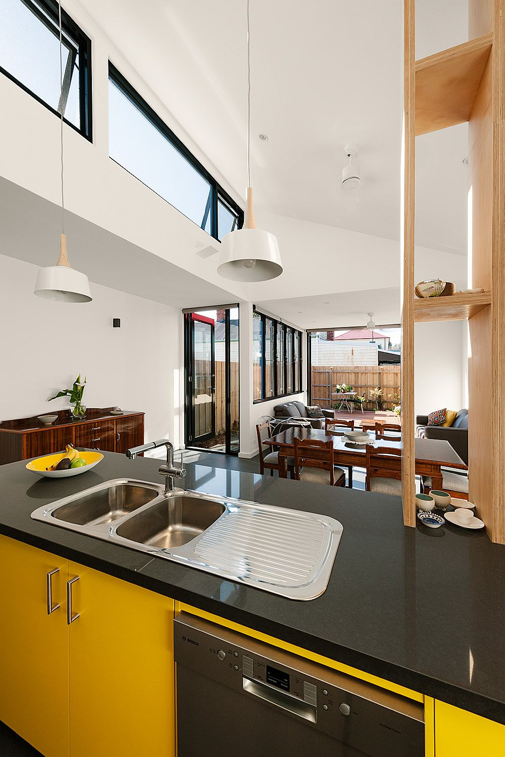 Clerestory-windows-bring-ample-natural-light-into-the-new-kitchen-and-living-area
