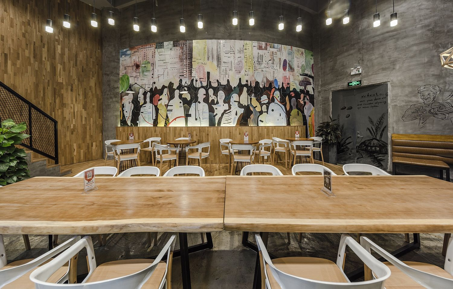 Colorful-wall-mural-and-edgy-wooden-tables-inside-the-Original-Bakery
