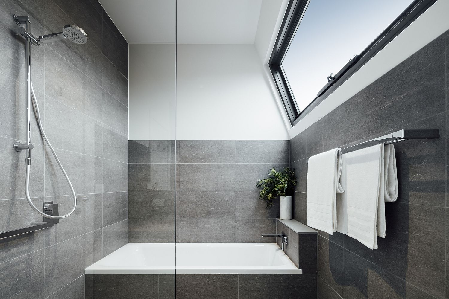 Contemporary bathroom in gray with ample natural light