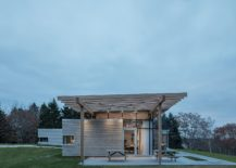 Covered-outdoor-patio-in-concrete-extends-the-living-area-217x155