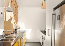 Custom-wooden-shelf-separates-the-living-area-from-the-kitchen-217x155