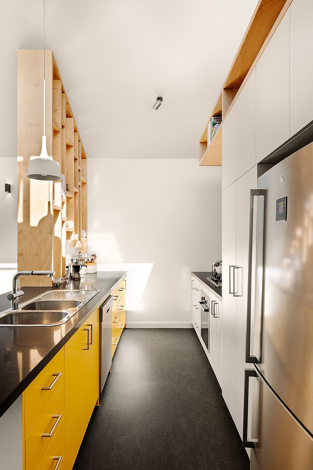 Custom-wooden-shelf-separates-the-living-area-from-the-kitchen