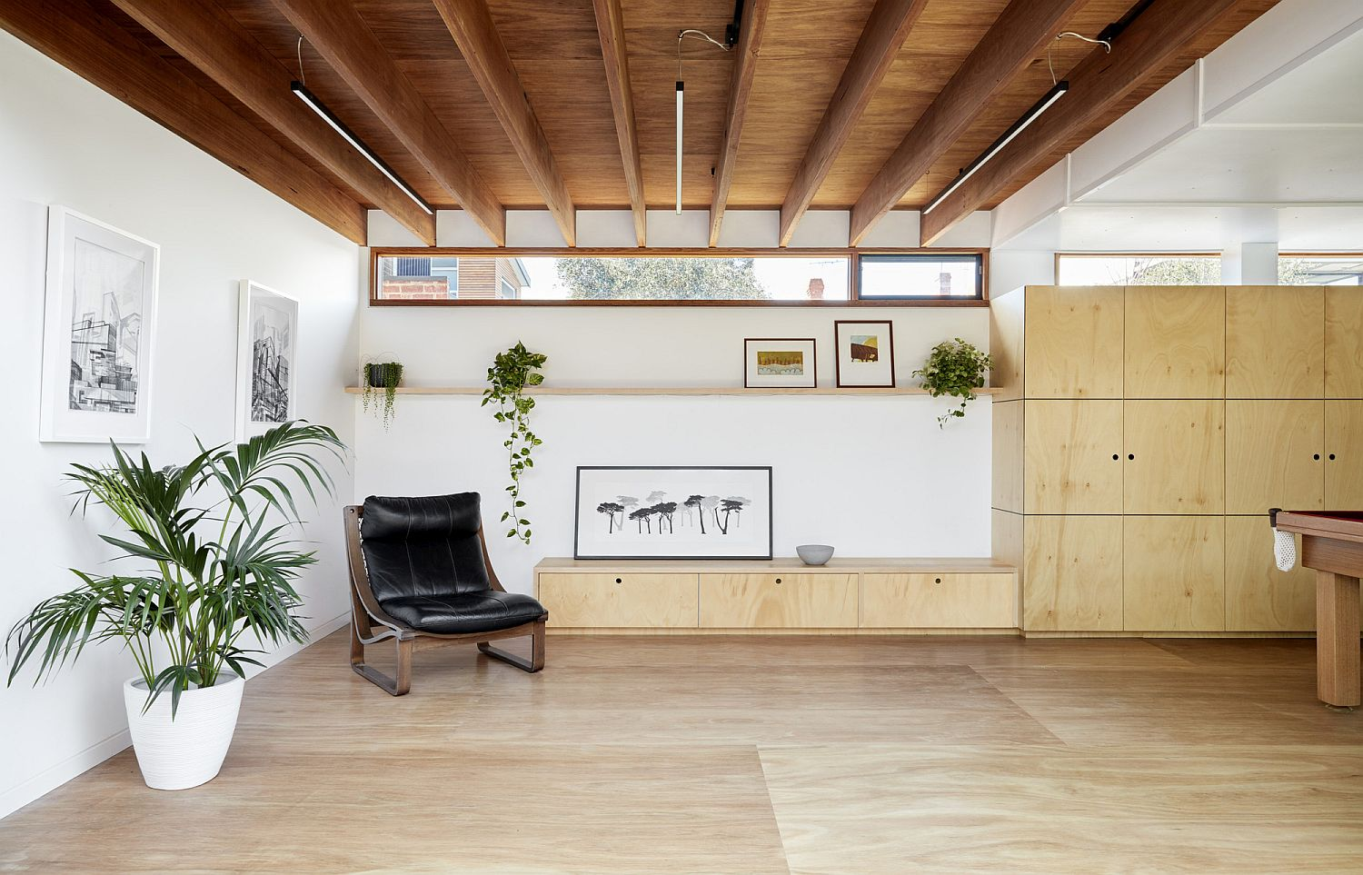 Custom-wooden-shelving-and-cabinets-for-the-modern-interior-in-white