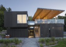 Dark-exterior-of-the-building-draws-inspiration-from-the-landscape-around-it-217x155