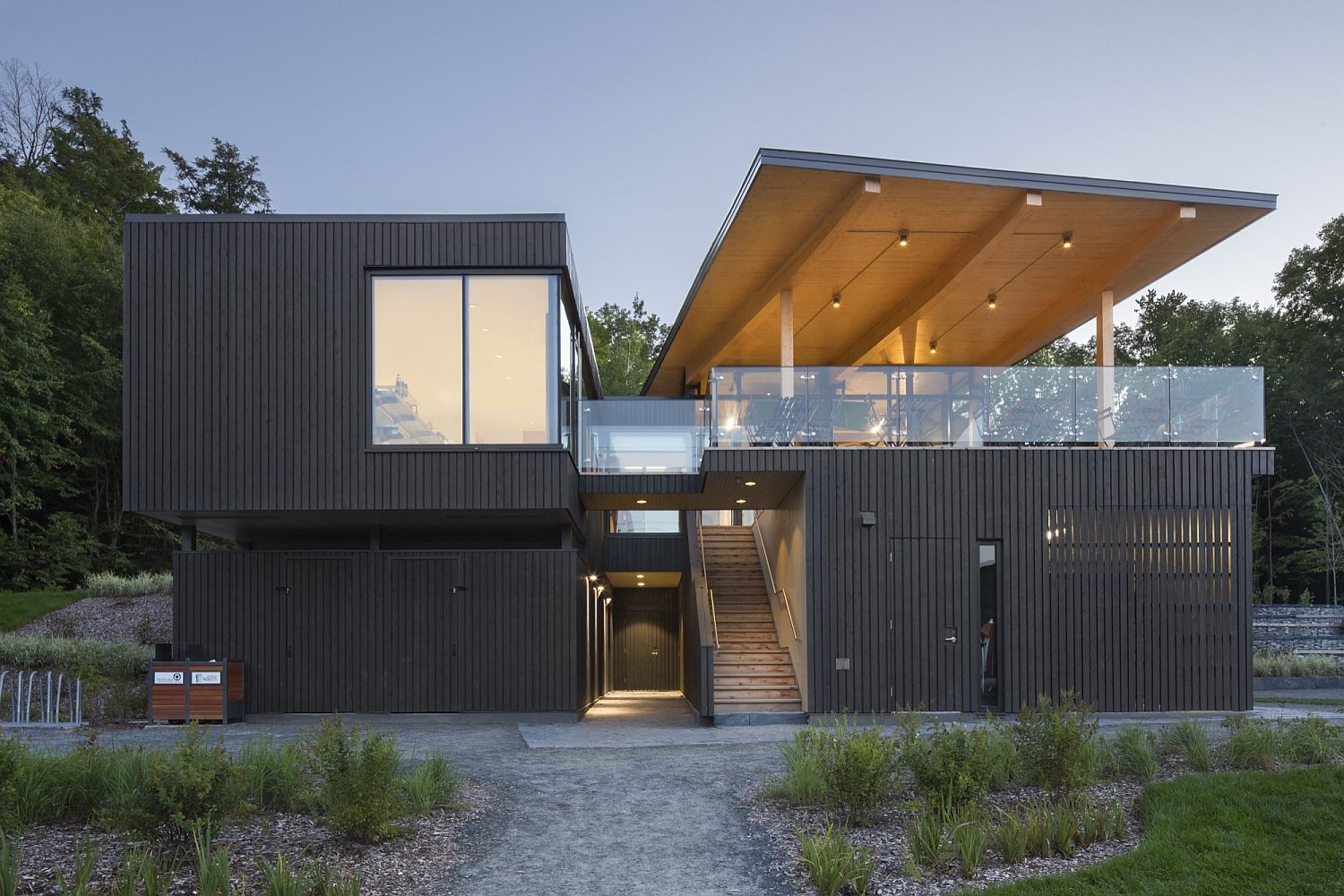 Dark exterior of the building draws inspiration from the landscape around it