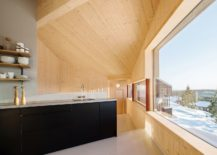 Dark-kitchen-island-complements-the-dark-exterior-of-the-cabin-217x155