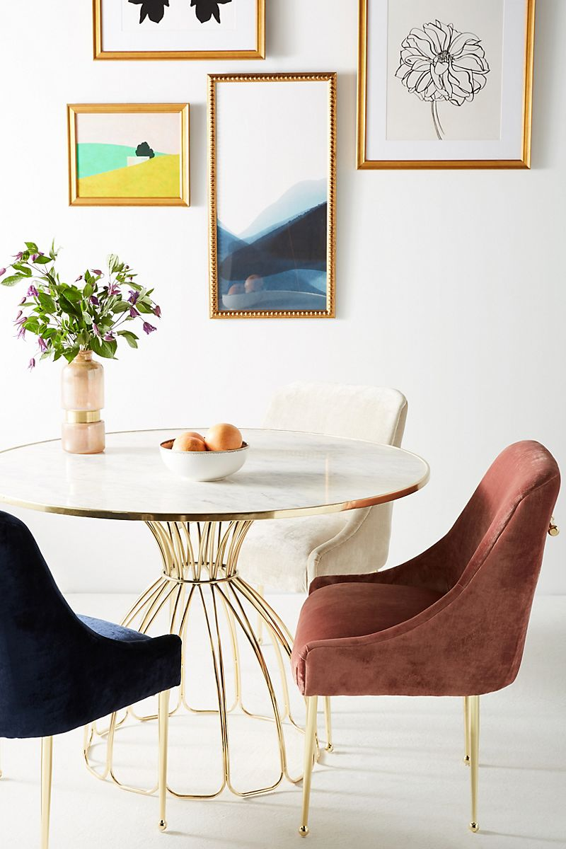 Dining chairs in velvet and brass