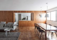 Expansive-wooden-panelling-creates-a-private-bedroom-and-a-fabulous-kitchen-217x155