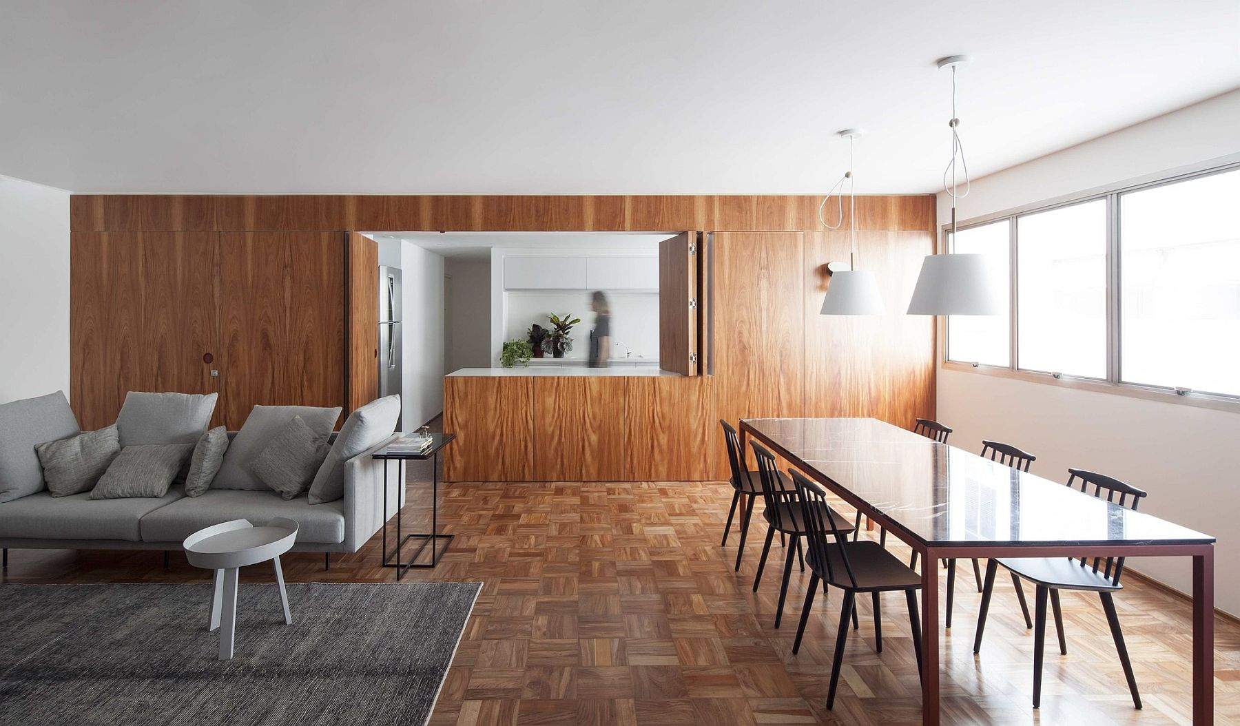 Expansive wooden panelling creates a private bedroom and a fabulous kitchen