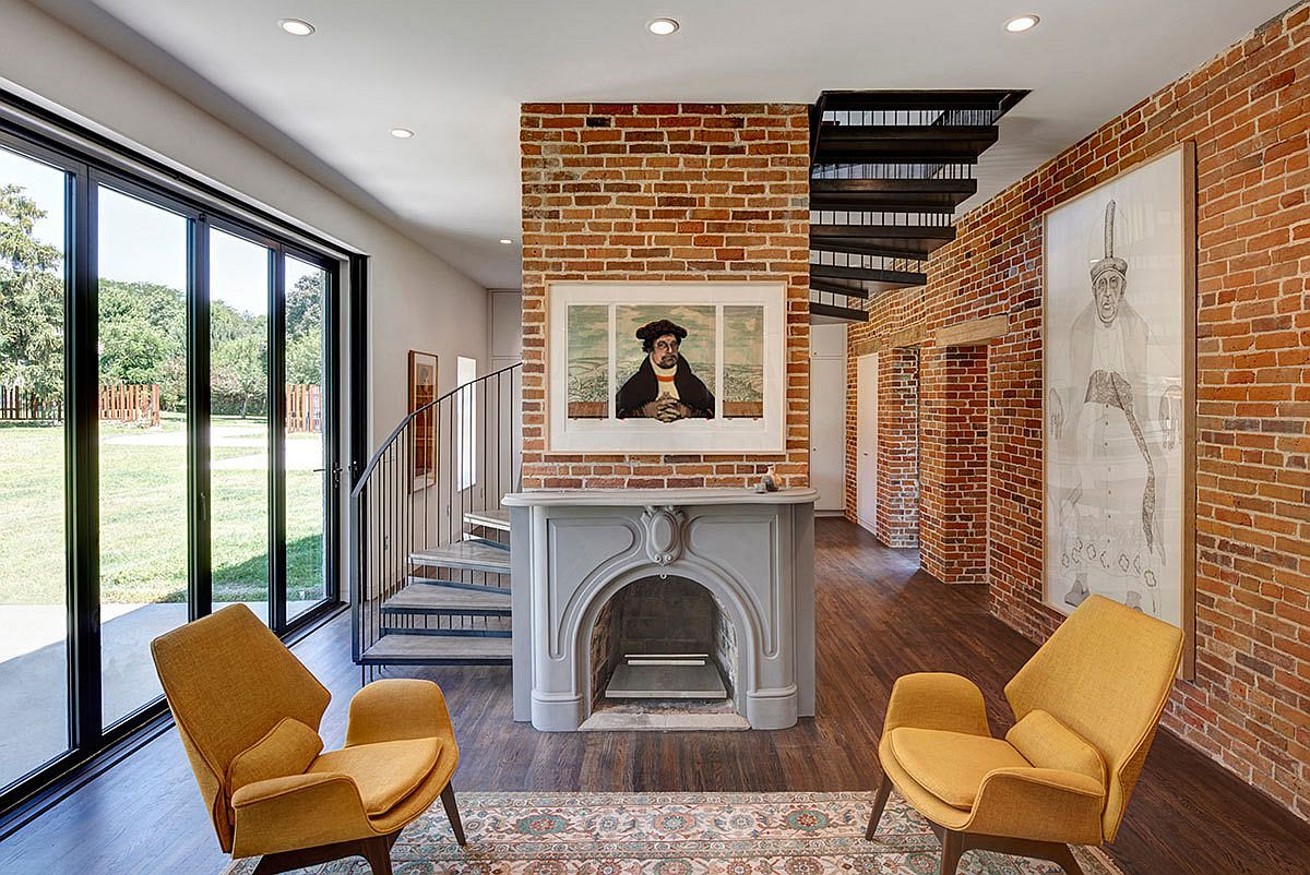 Exposed brick walls and a spiral stairway shape the new interior
