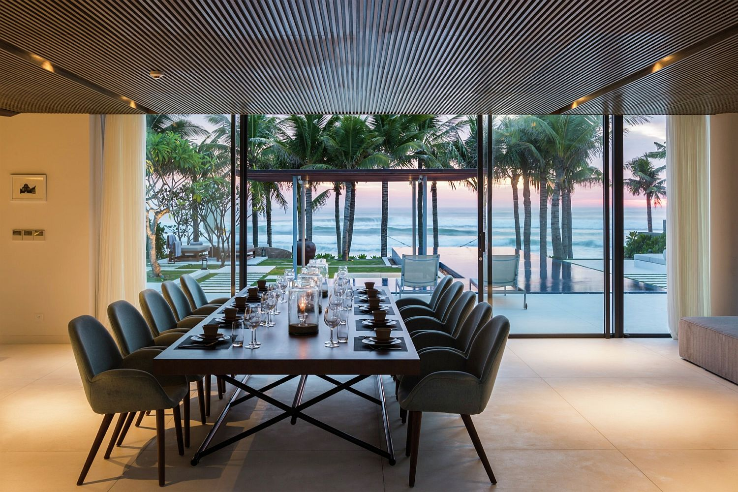 Exquisite dining room with a view of the sea and pool and deck outside