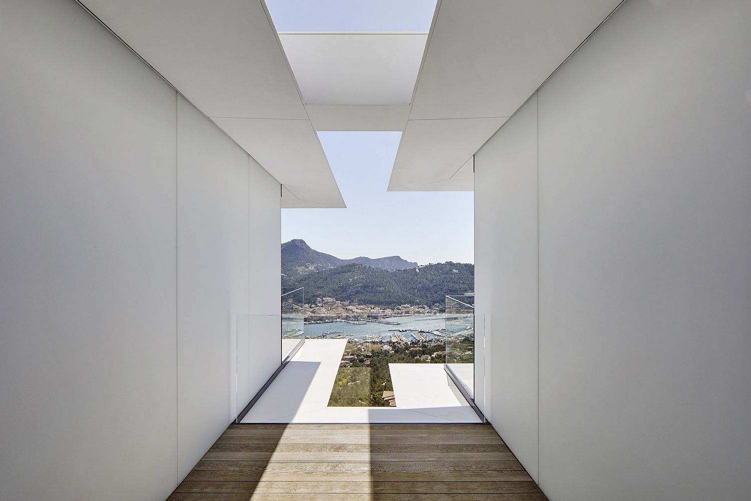 Filtered sunlight reaches the lower levels of the stunning contemporary Spanish home