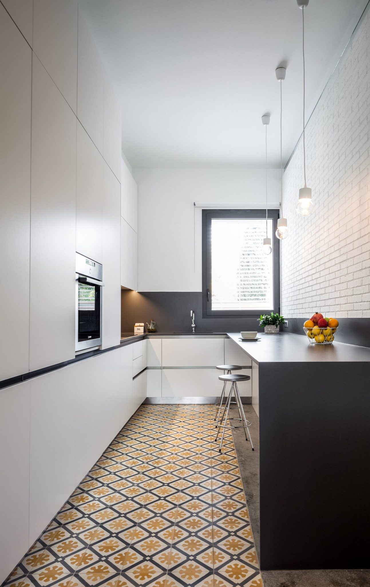Floor-tiles-bring-color-and-pattern-to-contemporary-kitchen-in-white