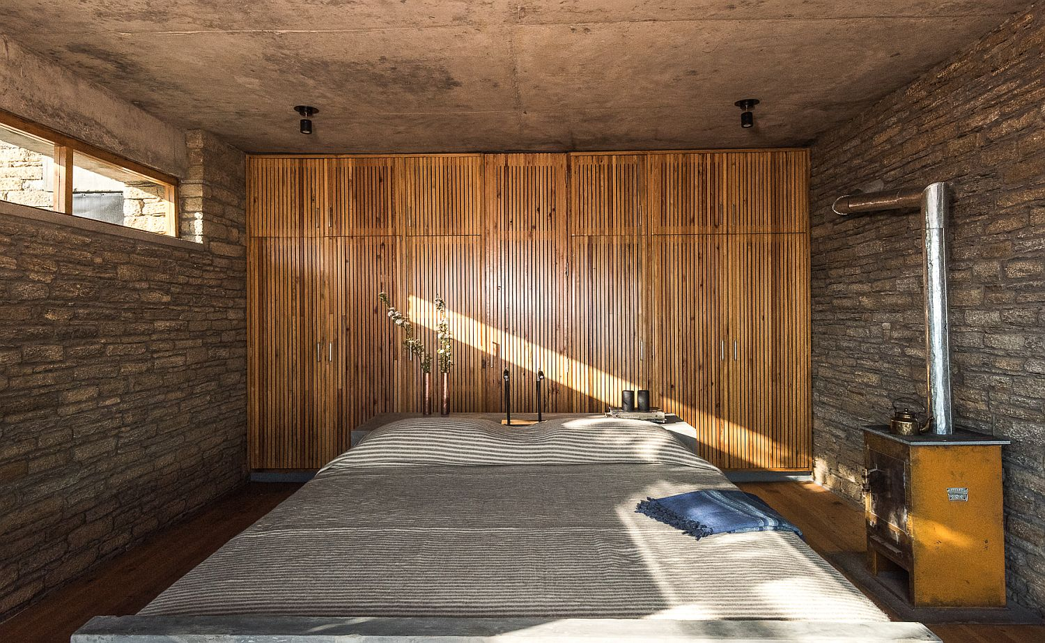 Fly ash bricks and bamboo create a rustic environment inside the bedroom
