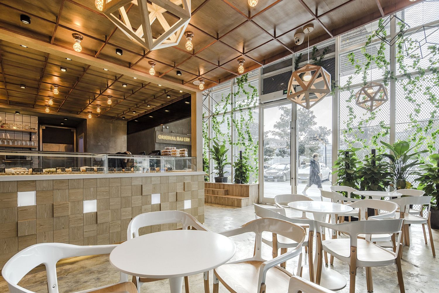 Geometric pendant lights and gorgeous greenery give the restaurant a unique look