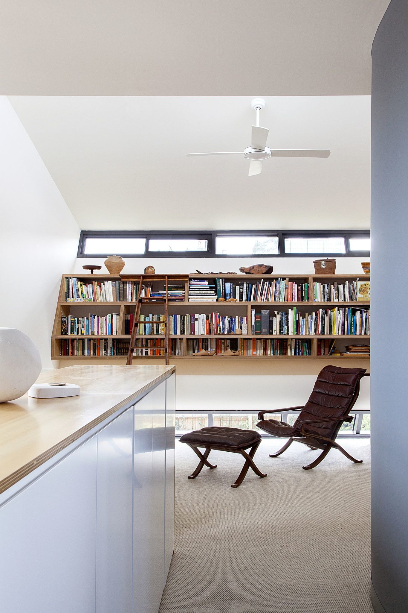 Home-office-in-white-with-ample-shelf-space-for-books