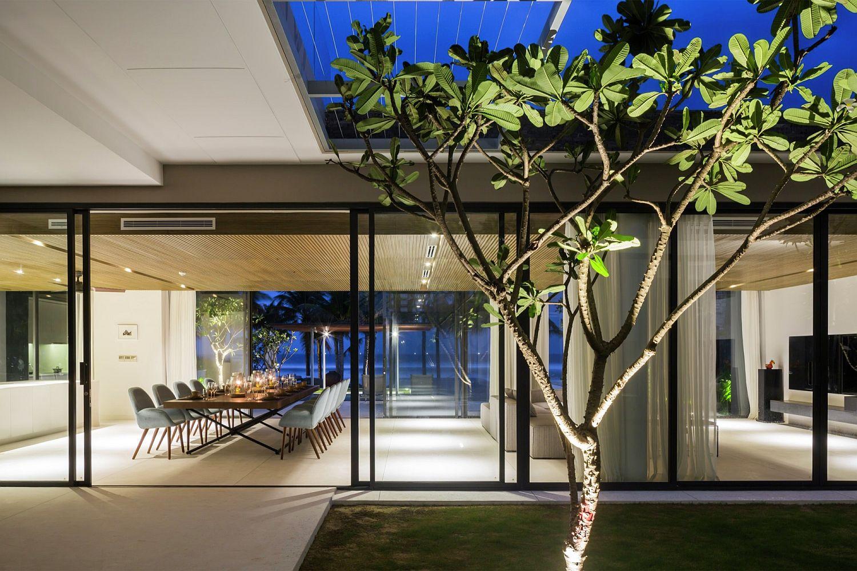 Illuminated tree and landscape around the seaside home
