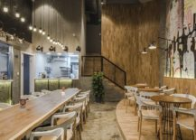Large-dining-area-and-industrial-lighting-provide-a-wonderful-ambiance-217x155