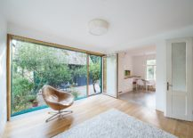 Large-glass-wall-replaces-the-old-walls-to-bring-in-natural-light-217x155