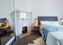 Large-mirror-in-the-bedroom-gives-the-room-a-more-spacious-appeal-217x155