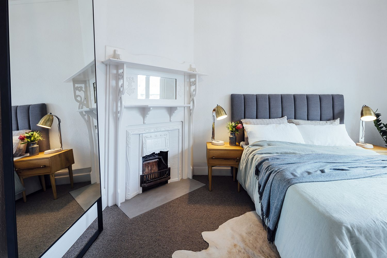 Large mirror in the bedroom gives the room a more spacious appeal