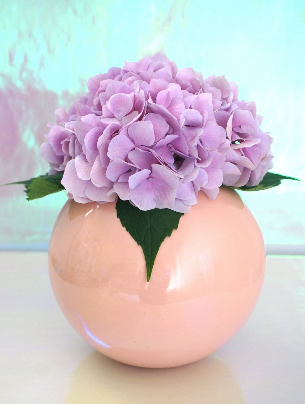 Lavender-hydrangea-in-a-peach-vase