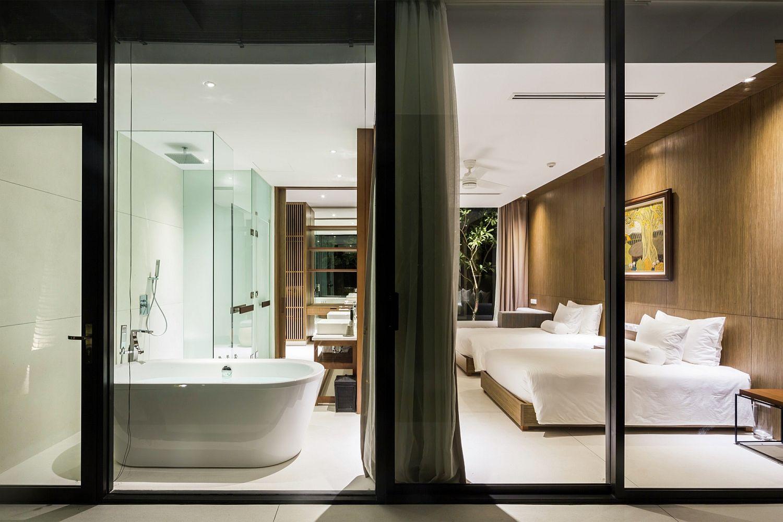 Lavish master bedroom with freestanding bathtub in the corner