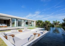 Luxurious-sunken-lounge-with-sea-views-and-infinity-pool-next-to-it-217x155