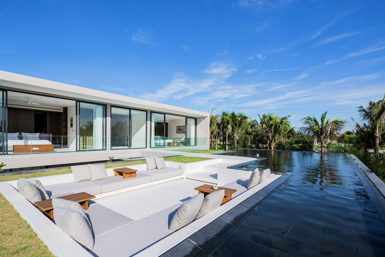 Luxurious sunken lounge with sea views and infinity pool next to it