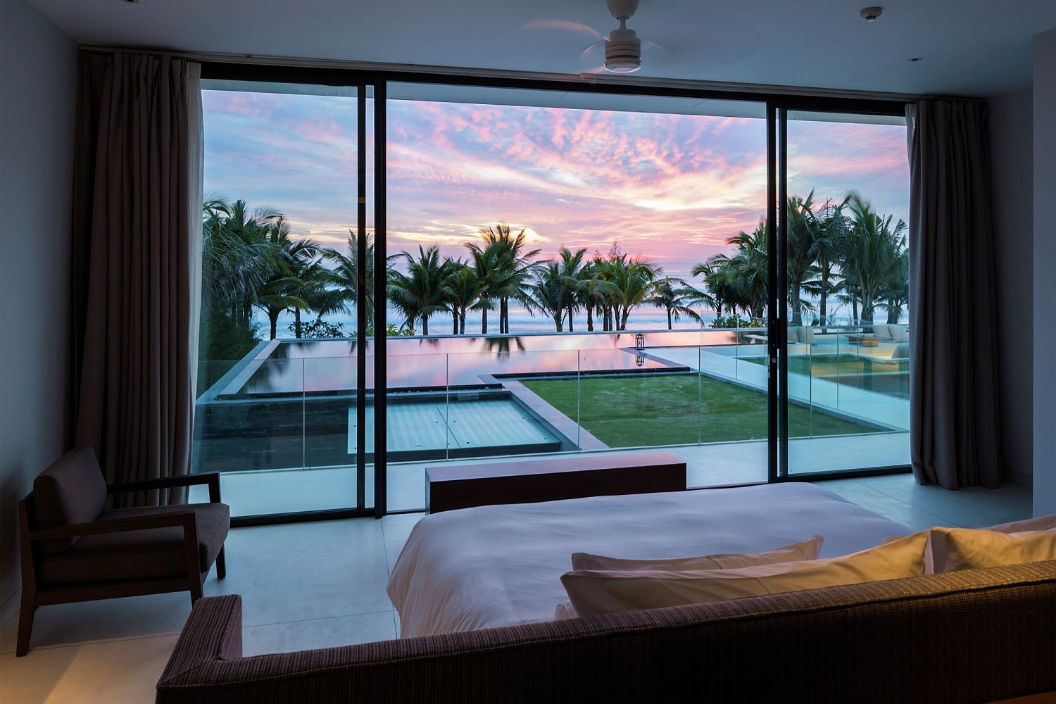 Mesmerizing view of the sea and the distant sunset from the comfort of your bedroom