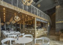 Metal-and-wood-shape-a-unique-interior-inside-the-restaurant-217x155