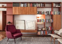 Metal-and-wood-shelf-in-the-living-room-brings-a-pop-of-bight-red-217x155