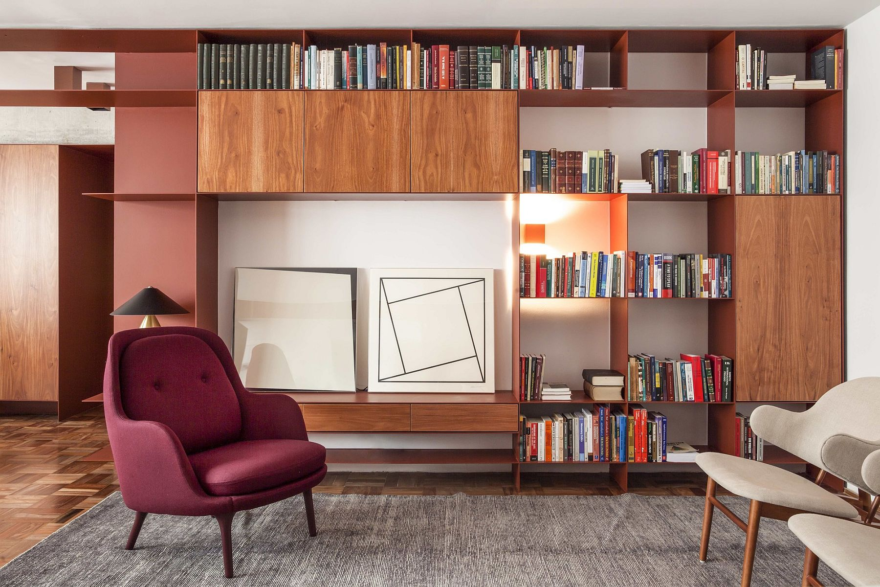 Metal and wood shelf in the living room brings a pop of bight red