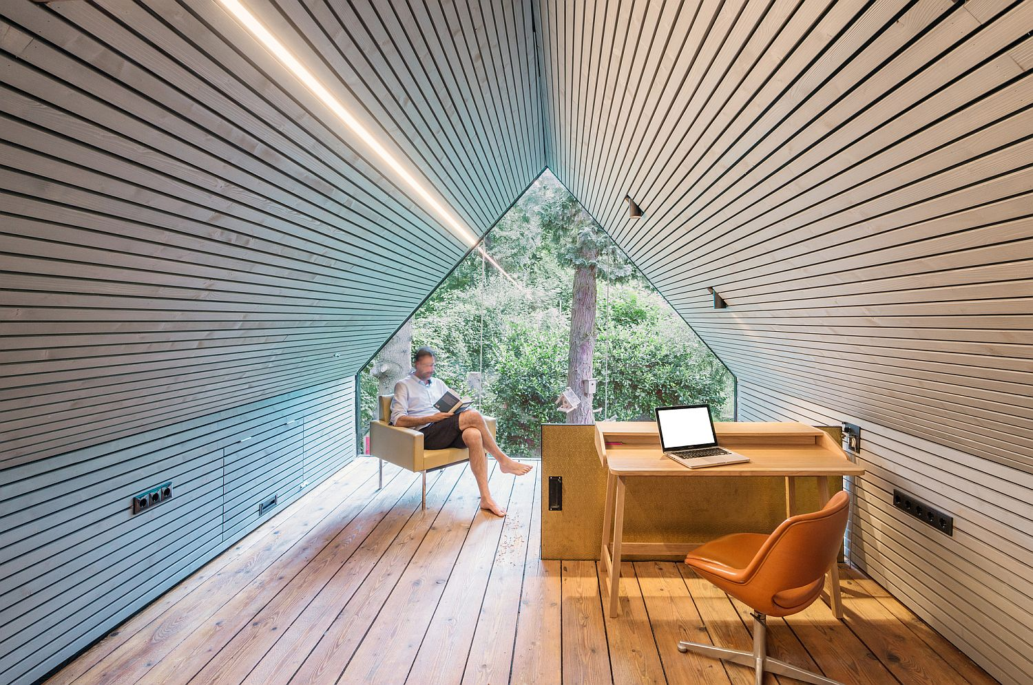 Minimal attic getaway with a workdesk and chair
