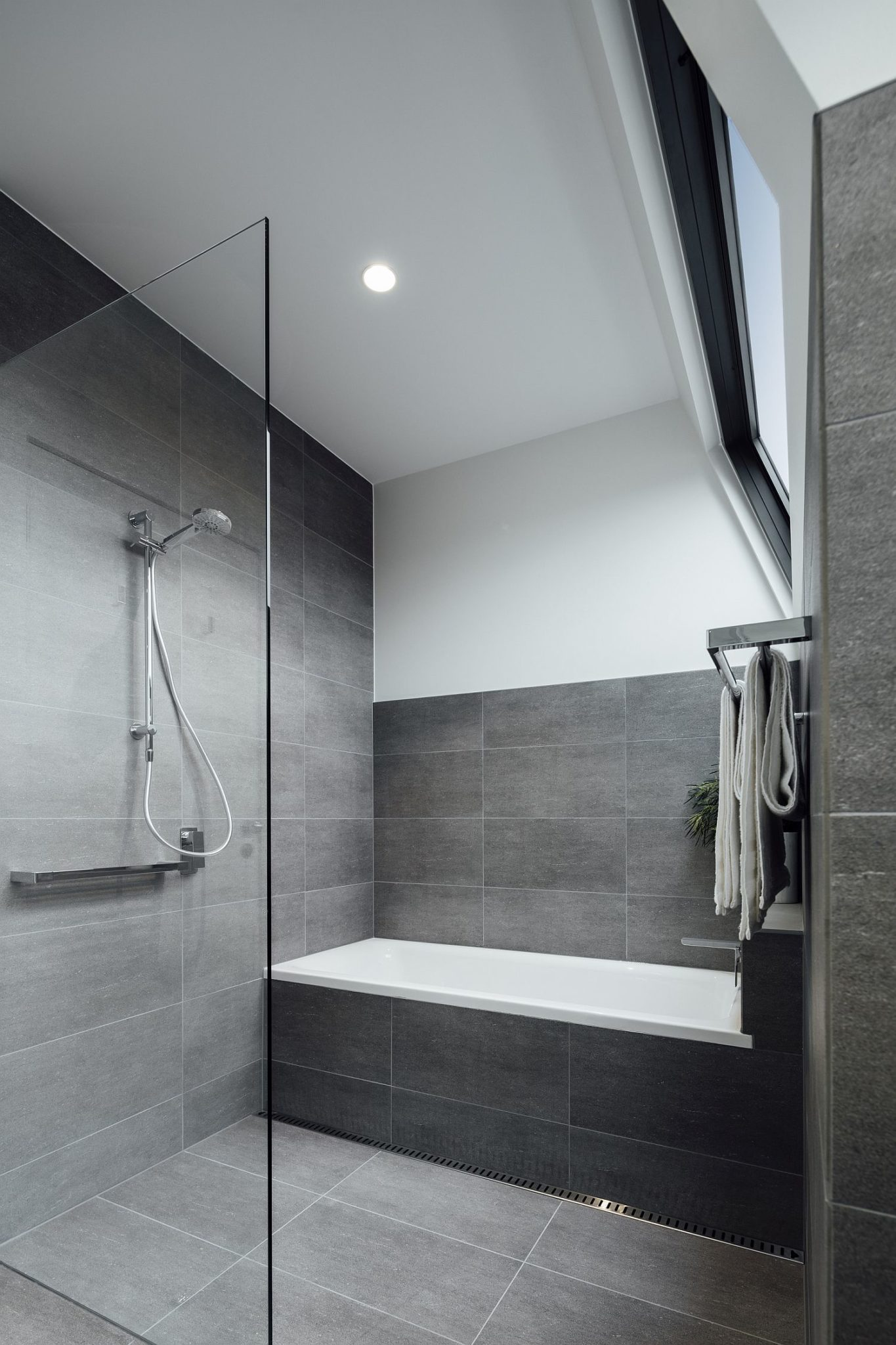 Minimal modern bathroom in white and gray
