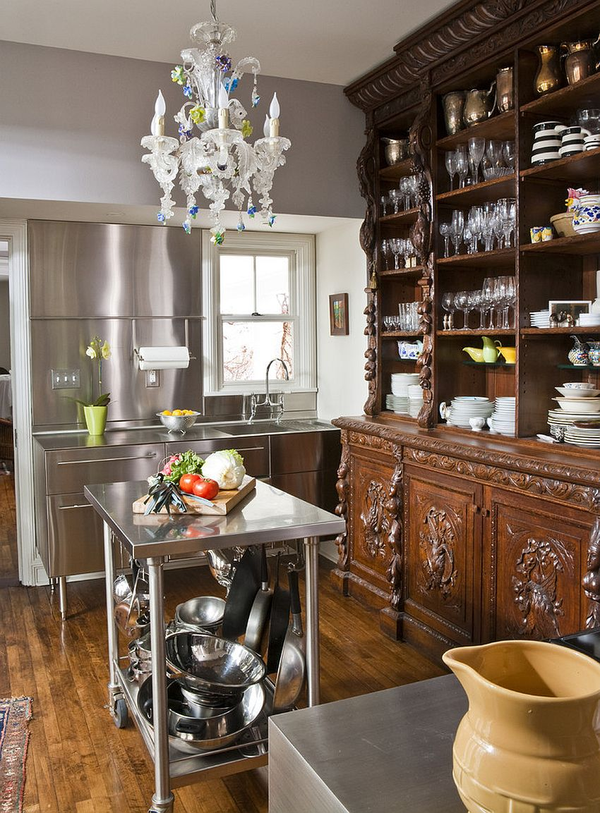 Modern eclectic kitchen with ornate wooden shelving and stainless steel island