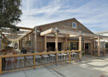 New-dining-area-and-cafe-at-the-transformed-auto-repair-shop-in-California-217x155