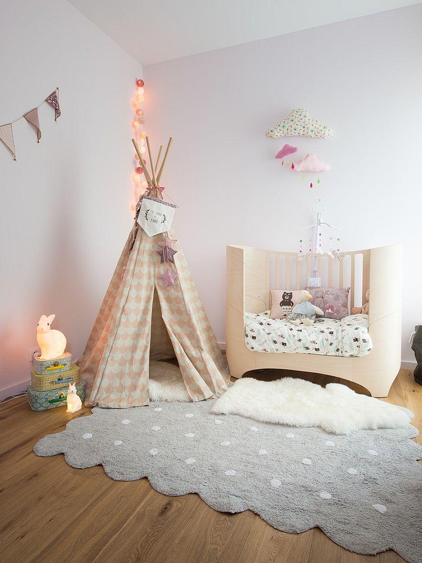 Nursery, teepee and rug create a cool nursery with pastel hues