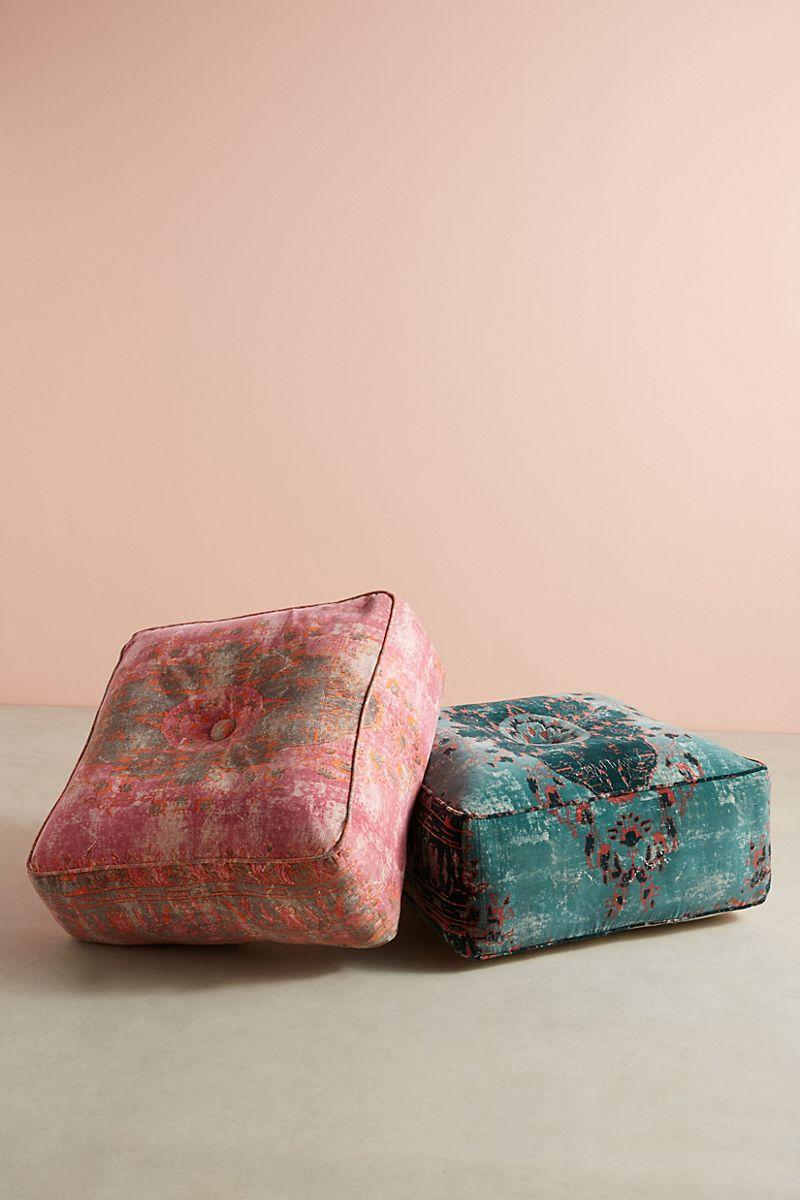 Patterned velvet ottomans in teal and fuchsia