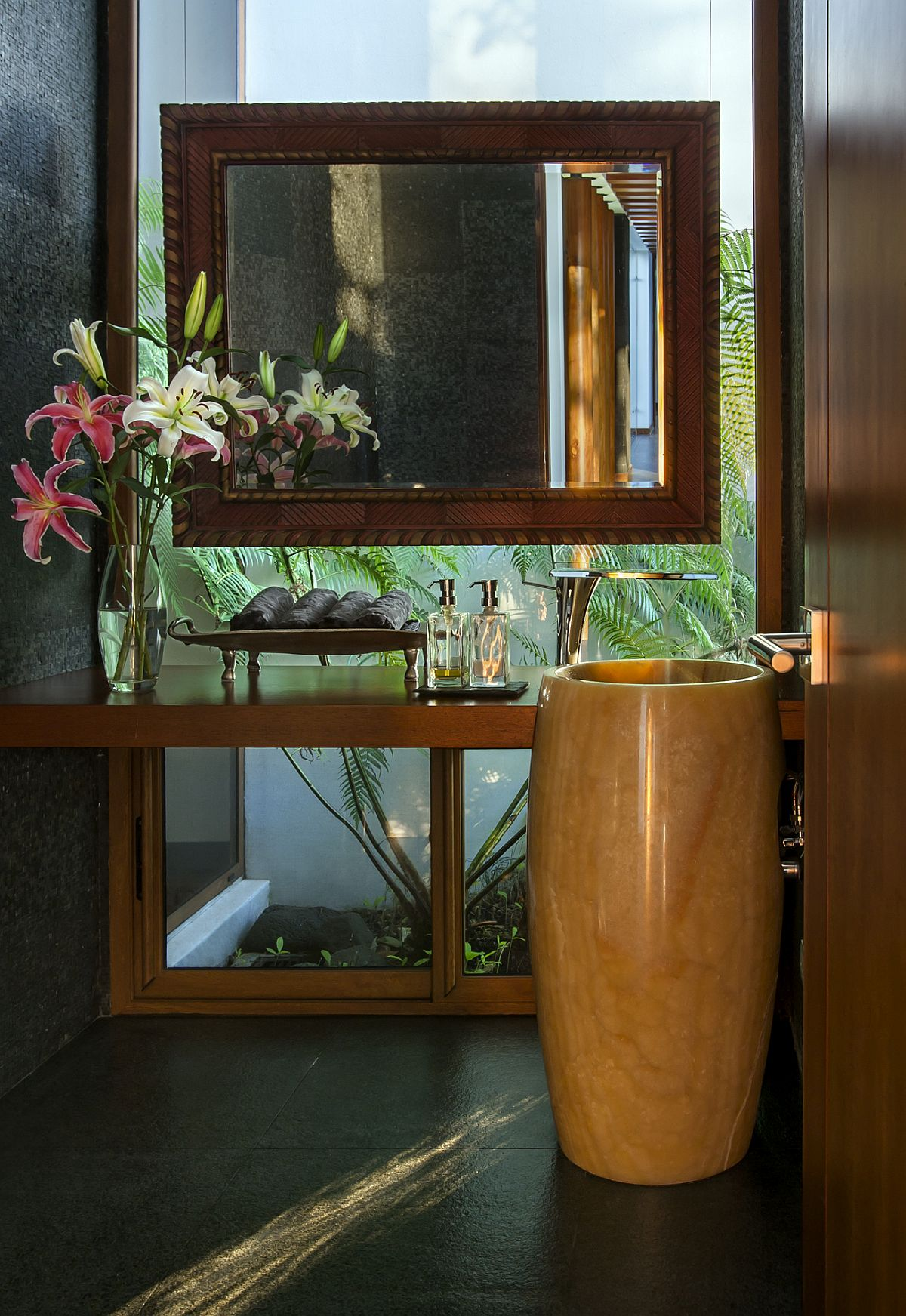 Powder-room-with-glass-wall-and-ample-natural-light