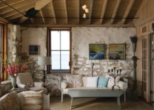 Rustic-approach-to-beach-style-living-room-design-with-exposed-walls-and-wooden-ceiling-217x155
