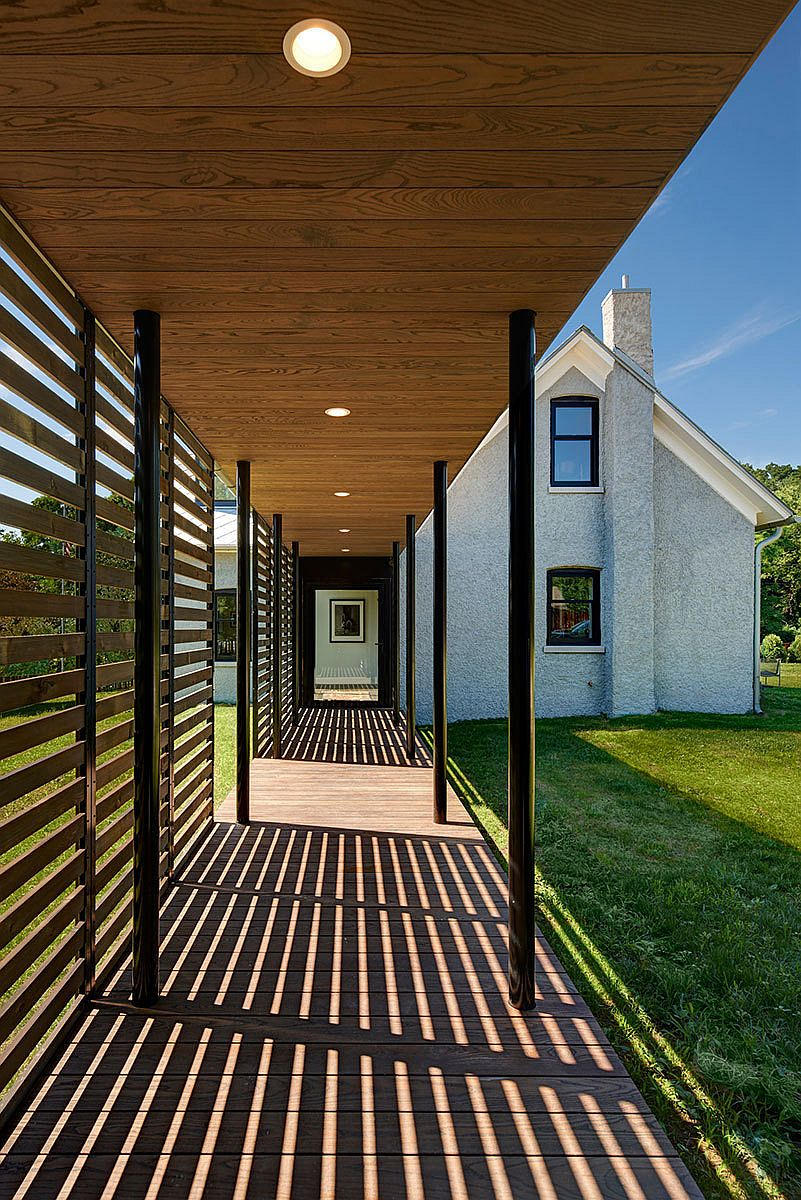 Sheltered walkways and a lovely garden create a wonderful outdoor escape